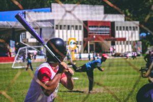 boys swinging the bat in baseball
